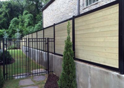 FenceTrac Privacy Fence on Retaining Wall