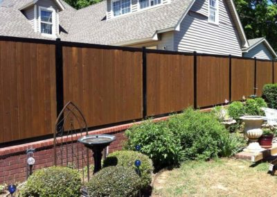 FenceTrac Privacy Fence on Brick Wall