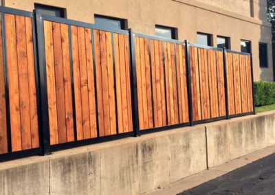 Commercial Privacy Fence on Retaining Wall