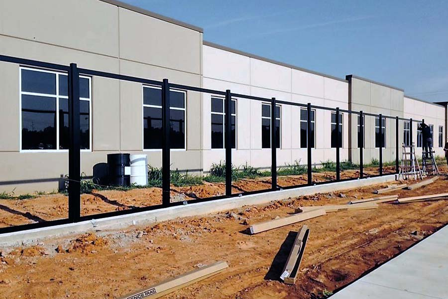 FenceTrac Commercial Privacy Fence Under Construction