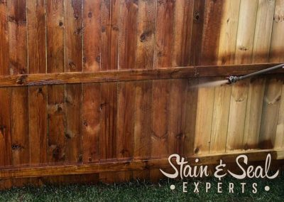 Spraying Cedar Fence Stain