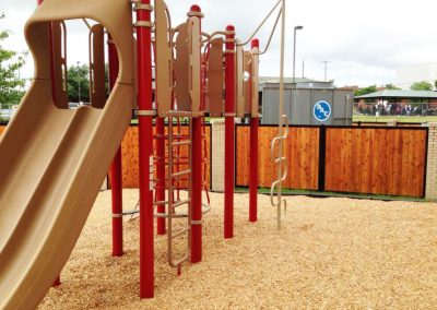 Vertical Stained Wood Metal Playground Fence