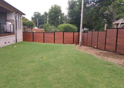 Horizontal Stained Wood Metal Privacy Fence Sloped Yard