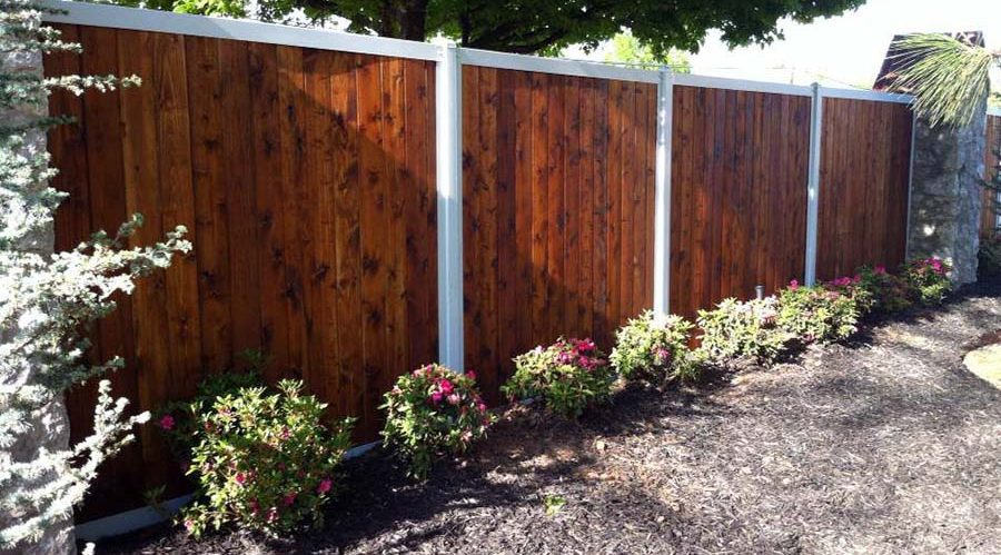 Stained Fence With White Trim