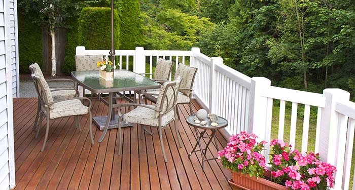 Stained Deck With White Railings