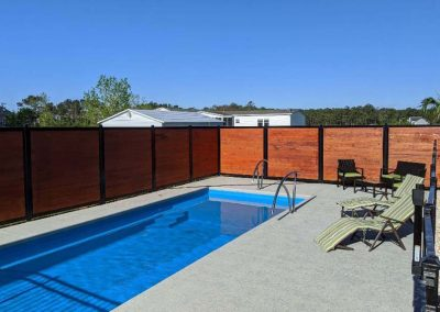Horizontal Pool Privacy Fence Metal & Stained Wood