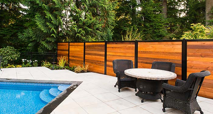Horizontal Privacy Fence Next to Pool Deck